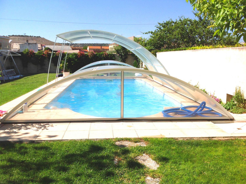 Cubiertas de piscinas bajas cubiertas para piscinas for Cubiertas de piscinas