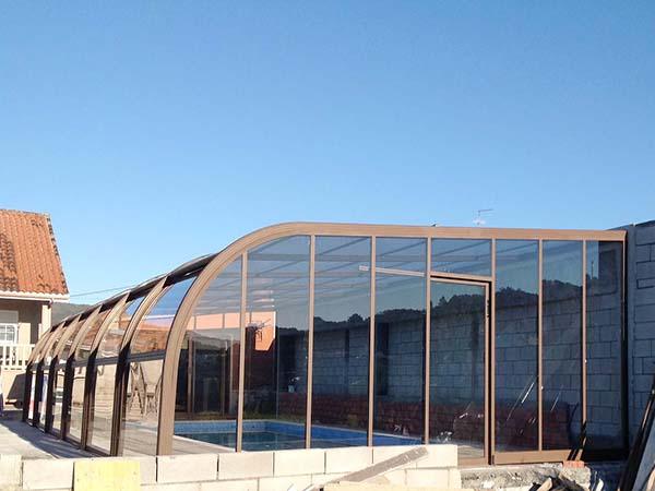 piscina cubierta forja adosada cubriland