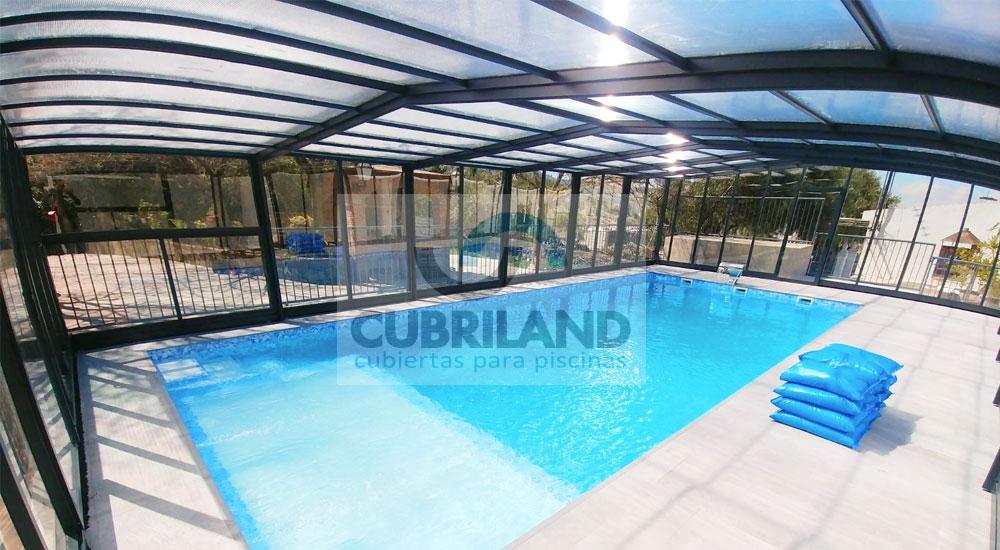 Cubrir las piscinas por seguridad y climatización CUBRILAND
